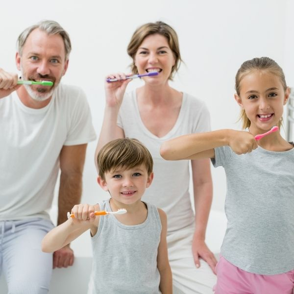 family members brushing their teeth