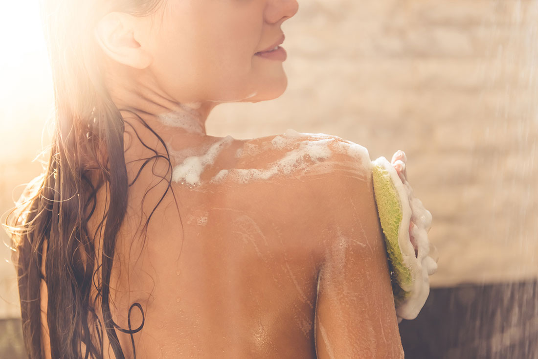 woman with shower gel
