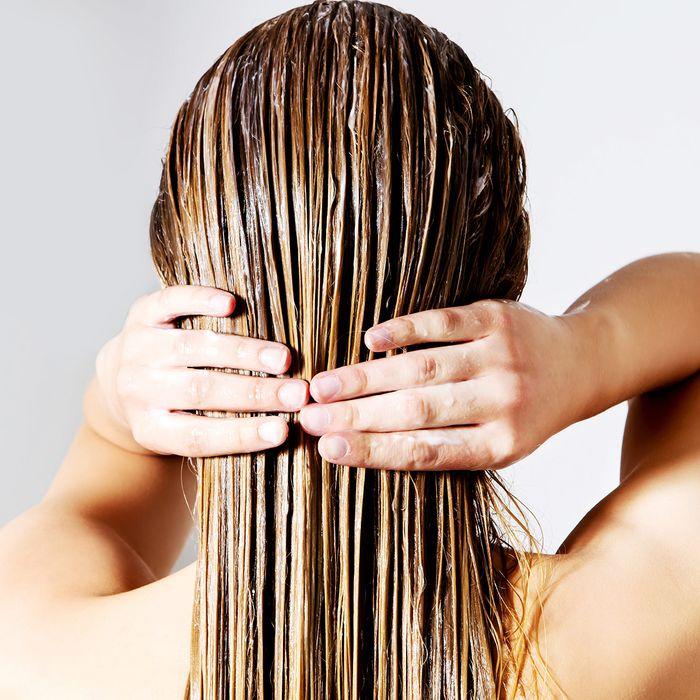 girl applying hair balm