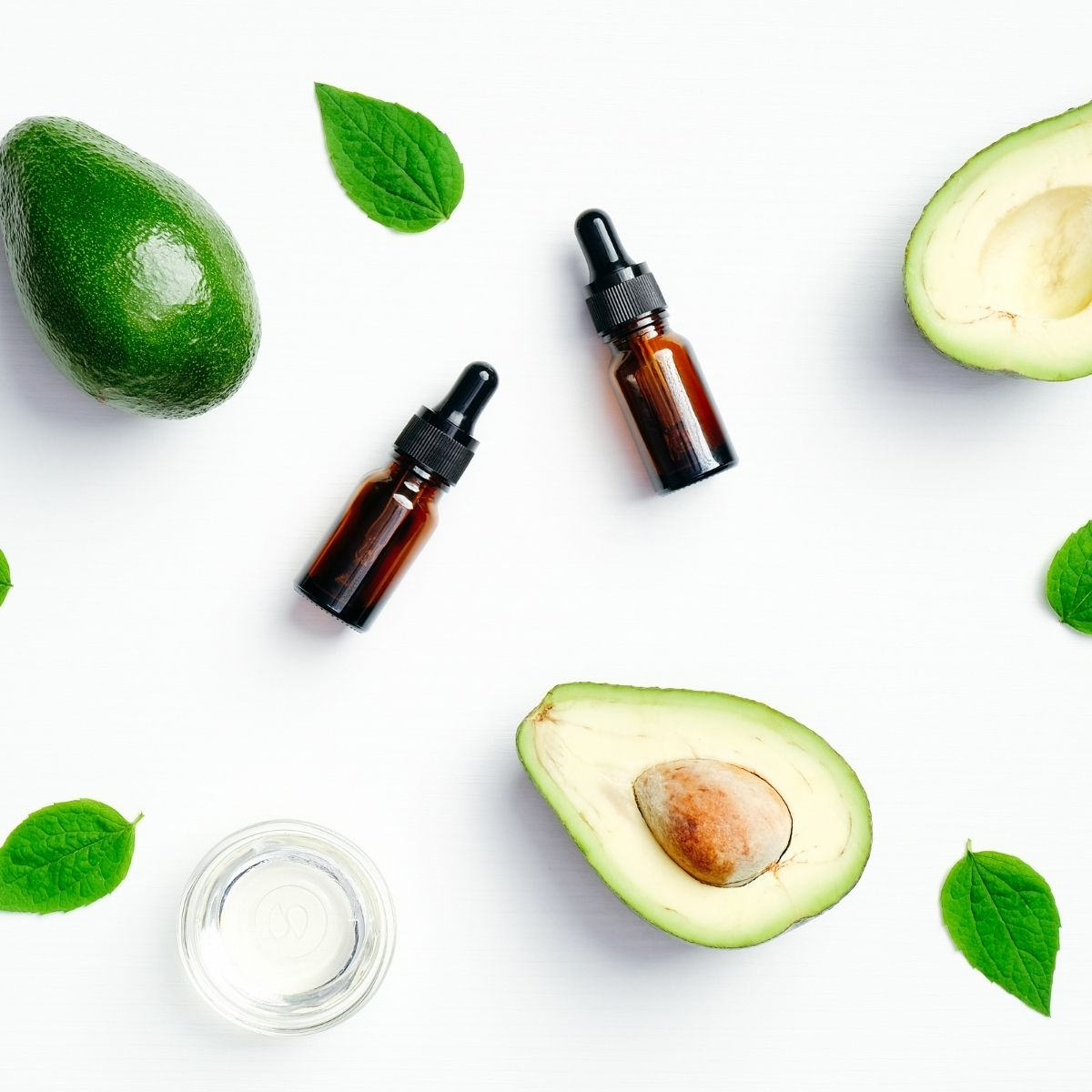 two bottles and avocado