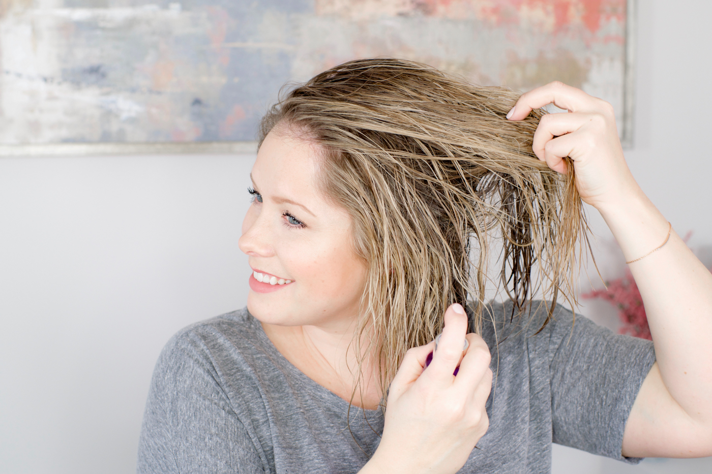 woman applying hair styling products