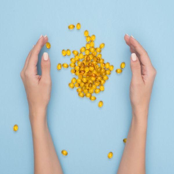 omega 3 pills in hands